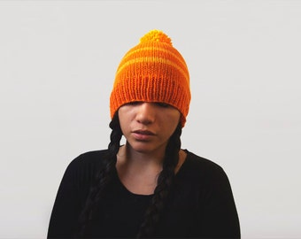 wool free vegan slouchy pom pom beanie -- bright neon orange with mango stripes