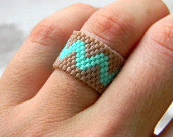 Beaded ring band Peyote beaded ring Unique ring jewelry Woven bead ring Elegant ring design Modern art ring Everyday ring styles Delica ring