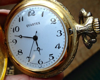 Vintage Quartex Pocket Watch with Fisherman on Front Swiss Parts and Movements