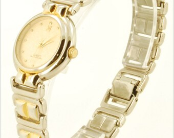 Japanese-movement quartz ladies vintage wrist watch, heavy yellow gold plated & stainless steel round case, matching bracelet-style band