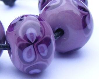 Lampwork flower bead set of 6 in purple, mauve and heliotrope