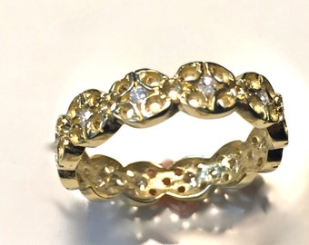 14 carat gold ring with diamonds.
