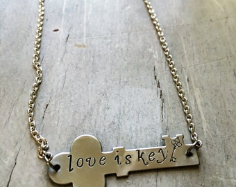 Love is key hand stamped necklace. Proceeds to Planned Parenthood. Inspirational. Love wins.