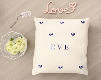 White pillow bow personalized with a name