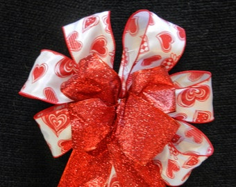 Valentine Bow White ribbon with red glitter hearts with a red glitter ribbon center