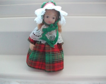 Pretty little doll in tartan and lace dress with matching bonnet