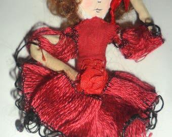 Small red dancer doll brooch