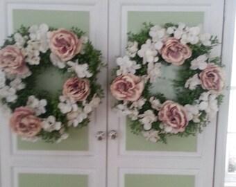 Two 18 inch rose wedding wreaths.