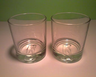 KETEL,  Made in ITALY.  Large K embossed on bottom of the glasses.