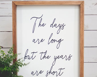 The days are long but the years are short- wood sign