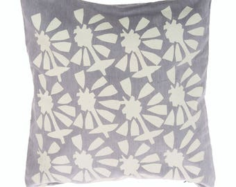 White and grey 'cut out floral' cushion cover.