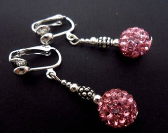 A pair of pretty pink shamballa style dangly clip on earrings.