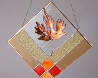 Stained glass panel with copper maple leaf