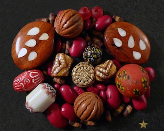 African glass beads, wood, seeds, brass and Terra cotta