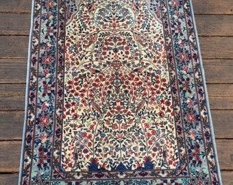 Small fine Persian rug