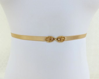 Gold Skinny Elastic Waist Belt. Gold Filigree buckle decorated with golden swarovski crystals. Thin stretch belt.