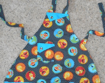 Sesame Street - Polka Dot - Girl's Apron - PBS - Elmo - Oscar the Grouch - Bert - Ernie - Pocket - Ruffle