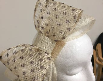 Stunning ladies cream bow fascinatore with coffee coloured spots!