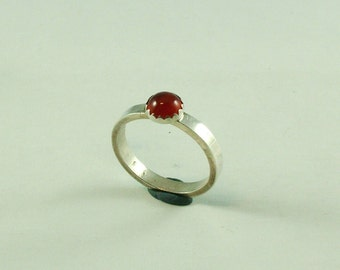 Silver ring with carnelian 6 mm in ornamental settings