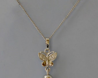 necklace with pearl pendant and butterfly decor