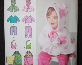 Simplicity 1564   Babies Top, Pants, Capelet, Bib and One Size Blanket Wrap in Sizes XXsmall - Large
