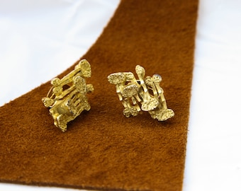 Unique vintage gold brass earrings with clips.