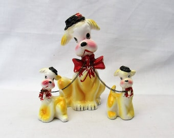 vintage Dog Figurine with chain puppies yellow dog set red bow and hat 1950s