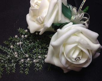 Elegant artificial double rose groom buttonhole