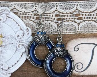 Metal and enamel earrings