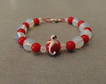 Bracelet with white glass Octopus