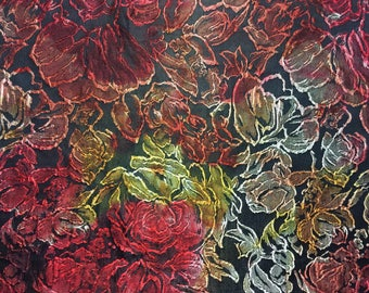"""Floral Brocade, Red, Orange, Yellow and hints of Gray,all contrasting against a Black backdrop, Price is per yard, 54"""" wide"""