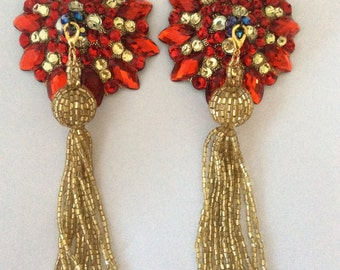 Red and gold pasties on gold base with removable gold beaded tassel