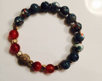 Blue marbled  and red Beaded bracelet with gold accents