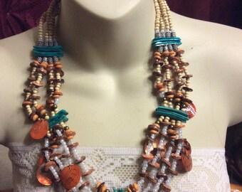 Multi strand tribal shells, bone , wood, white glass beads bib necklace