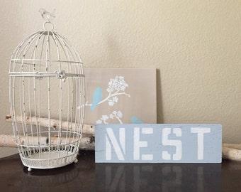 NEST Sign