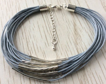 Silver plated noodle beads on waxed cord