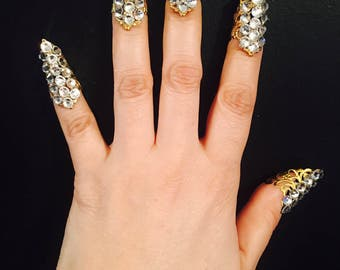 Set of 10pcs. Short crystal nail guards,claw rings or finger tips,made in gold color filigree with clear crystals, They are  sizable.