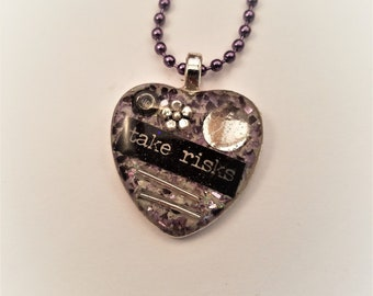 """Resin top heart pendant, bezel tray set with epoxy clay, abstract whimsical design, purple white background, inspirational words""""take risks"""""""