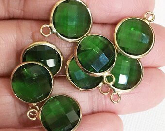 4 glass faceted flat round pendant with gold frame, Green glass drops 16x13mm, framed glass with brass setting