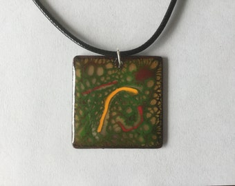 Multi Colored Enameled Pendant on Black Cord necklace