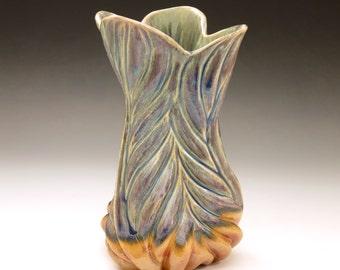 Hand carved porcelain vessel in purple, blue green & orange glazes, leaf design