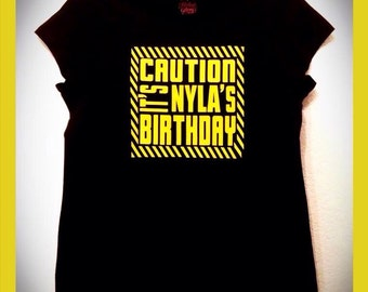 Caution Tape shirt, includes free name up to seven letters!