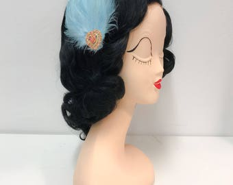 Feather hairclip with rhinestone embellishment, light blue and pink