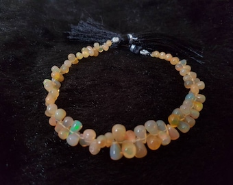 ETHIOPIAN OPAL SMOOTH Drops Shape Briolette , Size 4X5MM to 6X9Top Quality drop shapes. 8 Inch Strand , Strong fire , 43 carat weight