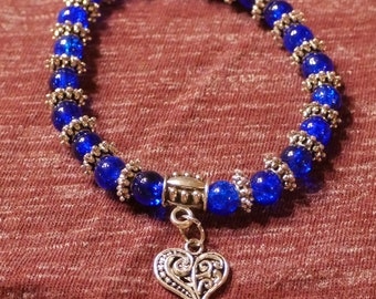 Vibrant blue bracelet with heart charm