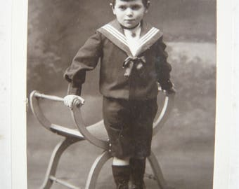 Young boy in sailor costume photography 1910 kid in nautical outfit studio portrait black and white pic retro clothing souvenir memorabilia
