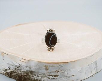 Black sardonic ring