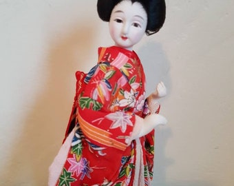 Vintage Japanese porcelain Geisha Maiko dressed traditional Kimino doll handpainted on wooden stand obi