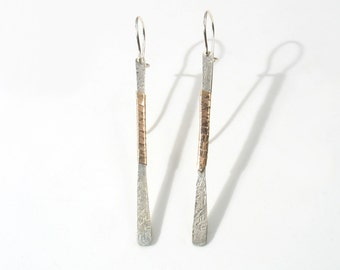 Solid Rose gold strap wrapped around the center of a 4.5 cm flat textured silver bar.Stick , long Bar Earrings - Geometric Line Earrings
