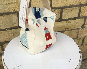 Beautiful handmade Small Door stop in seaside themed fabric, with Beach huts, Boats and bunting